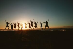 silhouette photography of group of people jumping during 1000445 - Kinden CPA